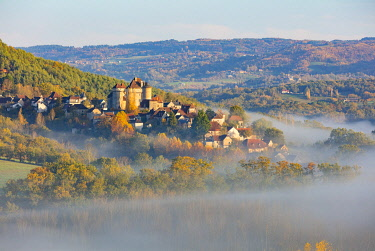 FRA11077AW Curemonte labelled l'un des plus beaux villages de France (most beautiful villages in France) in the morning mist in the autumn, Correze, Nouvelle-Aquitaine, France
