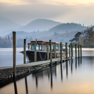 ENG16108AW England, Cumbria, Keswick. Launch moored on Derwent Water.