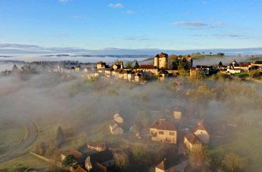 FRA11095AW Curemonte labelled l'un des plus beaux villages de France (most beautiful villages in France) in the morning mist, Correze, Nouvelle-Aquitaine, France