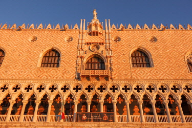 ITA13527AW Sun Rays at Sunrise through the Arches of Palazzo Ducale (Doge's Palace) St Mark Square, Venice, Veneto, Italy.