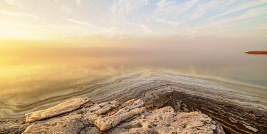JOR0905AW Salt Formations on the shore of the Dead Sea at sunset, Karak Governorate, Jordan