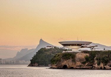 BRA3701AW View towards Niteroi Contemporary Art Museum MAC, Boa Viagem Island, Corcovado Mountain and Pedra da Gavea, sunset, Niteroi, State of Rio de Janeiro, Brazil