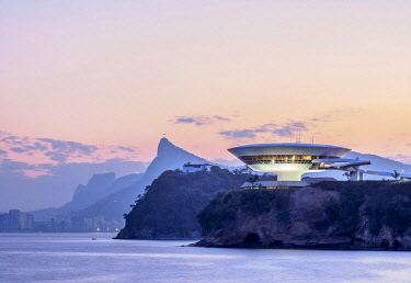 BRA3702AW View towards Niteroi Contemporary Art Museum MAC, Boa Viagem Island, Corcovado Mountain and Pedra da Gavea, dusk, Niteroi, State of Rio de Janeiro, Brazil