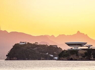 BRA3726AW View towards Niteroi Contemporary Art Museum MAC and Boa Viagem Island at sunset, Niteroi, State of Rio de Janeiro, Brazil