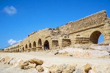 ISR0569AWRF Israel, Haifa District, Caesaria. Ruins of Roman aqueduct on the beach along the Mediterranean coast.