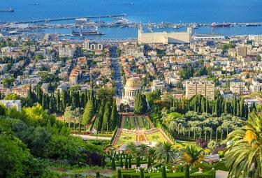ISR0598AWRF Israel, Haifa District, Haifa. Baha'i Gardens and buildings in downtown Haifa seen from Mount Carmel.