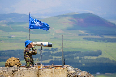 ISR0632AW UN observer monitoring UNDOF positions in Syrian territory from Mount Avital / Tall Abu an Nada, northern Golan Heights.