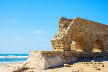 ISR0641AW Israel, Haifa District, Caesaria. Ruins of Roman aqueduct on the beach along the Mediterranean coast.