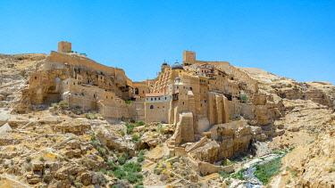 ISR0667AW Palestine, West Bank, Bethlehem Governorate, Al-Ubeidiya. Mar Saba monastery, built into the cliffs of the Kidron Valley in the Judean Desert.
