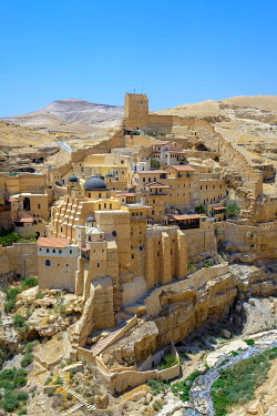 ISR0671AW Palestine, West Bank, Bethlehem Governorate, Al-Ubeidiya. Mar Saba monastery, built into the cliffs of the Kidron Valley in the Judean Desert.