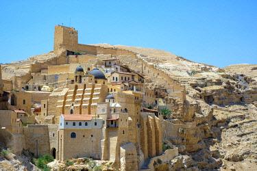 ISR0673AW Palestine, West Bank, Bethlehem Governorate, Al-Ubeidiya. Mar Saba monastery, built into the cliffs of the Kidron Valley in the Judean Desert.