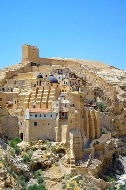 ISR0674AW Palestine, West Bank, Bethlehem Governorate, Al-Ubeidiya. Mar Saba monastery, built into the cliffs of the Kidron Valley in the Judean Desert.