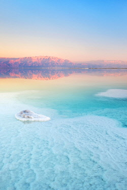 ISR0897AW Israel, South District, Ein Bokek. Salt formations on the Dead Sea at sunset.