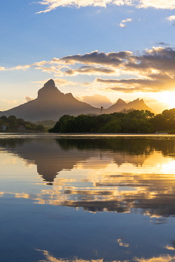 CLKAC103120 Rempart mountain reflected in Tamarin bay at sunrise. Tamarin, Black River (Riviere Noire), Mauritius, Africa