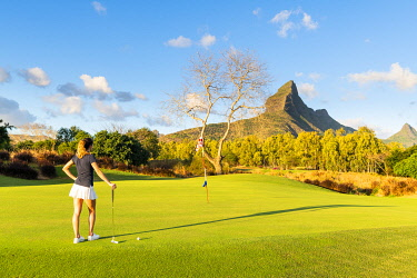 CLKAC103175 The golf course of the Tamarina Golf club with Rempart mountain in the background. Tamarin, Black River (Riviere Noir), Mauritius, Africa (MR)