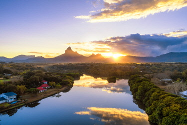 CLKAC103311 Aerial view of Tamarin bay with Rempart mountain in the background, during the sunrise. Tamarin, Black River (Riviere Noire), West coast, Mauritius, Africa