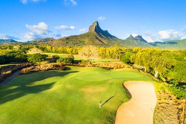 CLKAC103344 Aerial view of a woman playing golf. Tamarina golf club, Tamarin, Black River (Riviere Noir), Mauritius, Africa