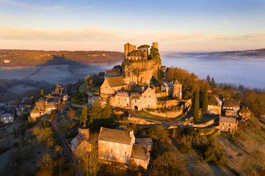 An aerial view of the hilltop village of Turenne at sunrise, Correze, Limousin, Nouvelle-Aquitaine, France