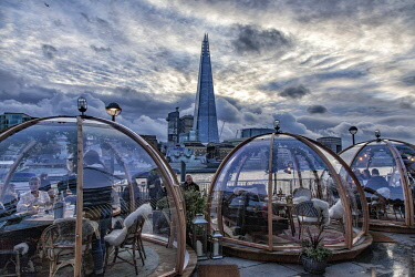 ENG16124 London Riverside Igloos at Tower Bridge offer a fine view over the Southbank with the Shard in the background, London, England
