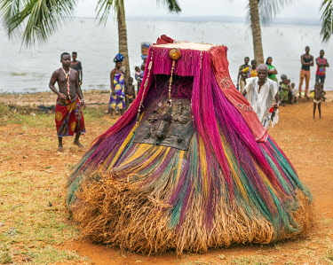 BNN0121 Benin, Bopa, Mono Department.  Zangbeto are traditional voodoo guardians and are highly regarded as unofficial policemen patrolling the streets at night. The costume resembles a haystack and is believ...