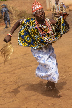 BNN0140 Benin, Allada, Atlantique Department.  A man seemingly dressed as a woman dances at a voodoo celebration.