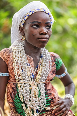 BNN0144 Benin, Allada, Atlantique Department.  A young girl wearing numerous necklaces attends a voodoo celebration.