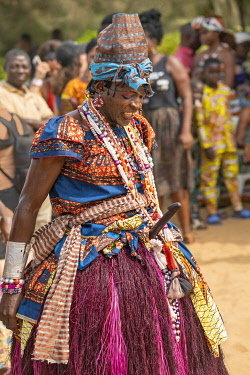 BNN0153 Benin, Ouidah, Atlantique Department.  A man dressed in female attire with a wooden phallus dances at voodoo celebrations in Ouidah to mark the annual voodoo festival held in January each year. Ouidah...