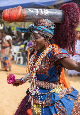 BNN0155 Benin, Ouidah, Atlantique Department.  A man in female attire with a huge wooden phallus balanced on his head dances at voodoo celebrations in Ouidah to mark the annual voodoo festival held in January...