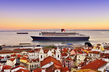 POR10221AW The iconic cruise ship Queen Mary II on the Tagus river facing the traditional moorish Alfama district. Lisbon, Portugal