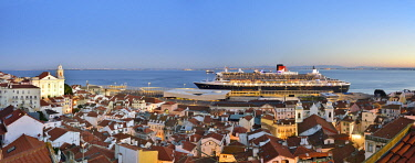 POR10222AW The iconic cruise ship Queen Mary II on the Tagus river facing the traditional moorish Alfama district. Lisbon, Portugal