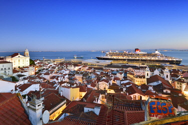 POR10223AW The iconic cruise ship Queen Mary II on the Tagus river facing the traditional moorish Alfama district. Lisbon, Portugal