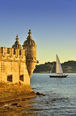 POR10235AW Torre de Belem (Belem Tower), in the Tagus river, a UNESCO World Heritage Site built in the 16th century in Portuguese Manueline Style at twilight. It was designed by the architect Francisco de Arruda...
