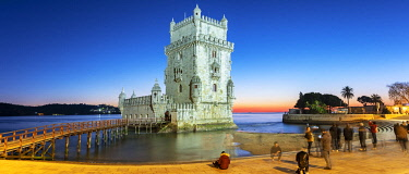 POR10238AW Torre de Belem (Belem Tower), in the Tagus river, a UNESCO World Heritage Site built in the 16th century in Portuguese Manueline Style at twilight. It was designed by the architect Francisco de Arruda...