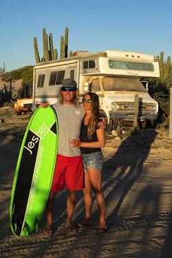 MEX1901AW Central America, Mexico, Mexican, Baja California, Sur, El Sargento, Surfing couple (MR)