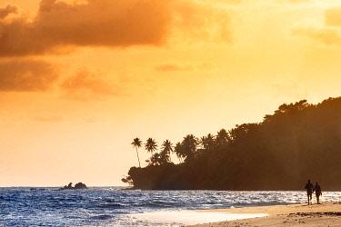 BRA3753AW South America, Brazil, Bahia, Tinhare island, Boipeba, a couple walking along an idyllic beach on Boipeba island
