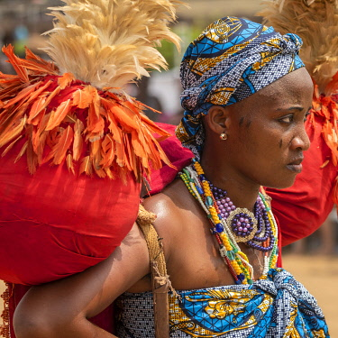BNN0342AW Africa, Benin, Ouidah. A woman with her costume during the Vodoun festival