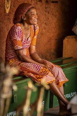 BNN0372AW Africa, Benin, Abomey. A saleslady in her craft shop.