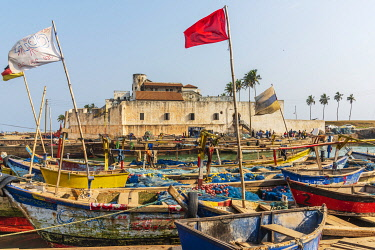 GHA0173AW Africa, Ghana, Elmina harbour. Traditional wooden fishing boats in the harbour in front of the famous castle.