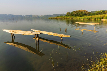 GHA0220AW Africa, Ghana, Lake Bosomtwe. The Ashanti people only fish from the traditional wooden padua.  This one million-year-old sacred lake was created when a giant meteorite crash landed in what was once a...