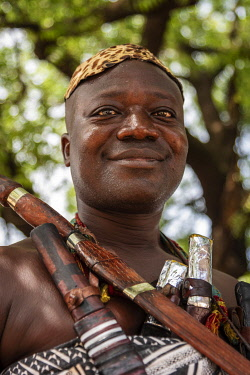 GHA0231AW Ghana, Kumasi, Akwasidae festival. A guardian of the King  traditionally armed and dressed at The Akwasidae Festival (alternate, Akwasiadae) is celebrated by the Ashanti people and chiefs in Ashanti,...
