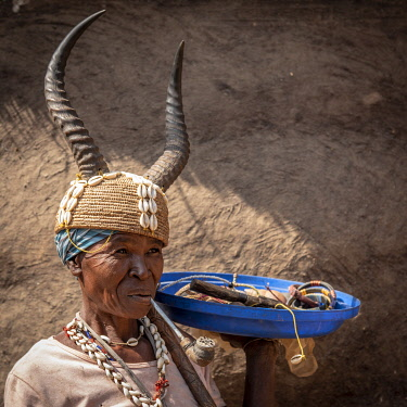 TOG0036AW Africa, Togo. Koutammakou, Tamberma. Unesco World Heritage site. Woman with the typical gazelle's headgear