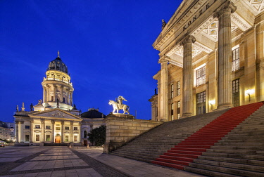 GER11689 The Gendarmenmarkt is a square in Berlin and the site of an architectural ensemble including the Konzerthaus (concert hall) and the French and German Churches. The latter shown in the photo. On the ri...