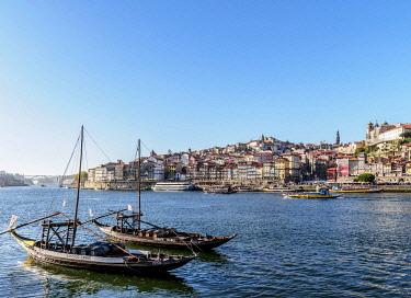 POR10334AWRF Traditional boats on Vila Nova de Gaia bank of Douro River, Porto Skyline in the background, Portugal