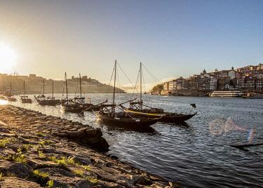POR10336AWRF Traditional boats on Vila Nova de Gaia bank of Douro River, Porto Skyline in the background, Portugal