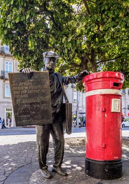 POR10352AW Newspaper Seller Statue and Traditional Mailbox, Praca da Liberdade, Porto, Portugal