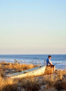 POR10426AW Man looking at the sea, Faro Beach, Ilha de Faro, Ria Formosa Natural Park, Faro, Algarve, Portugal