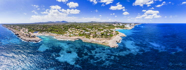 IBXMOX04795244 Drone shot, Rocky Coast with Villas and Hotels, Cala Tropicana and Cala Domingos, Porto Colom Region, Majorca, Balearic Islands, Spain, Europe