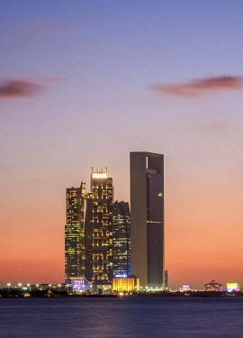 IBLKOZ04655945 Skyline with Etihad Towers at sunset, Abu Dhabi, United Arab Emirates, Asia