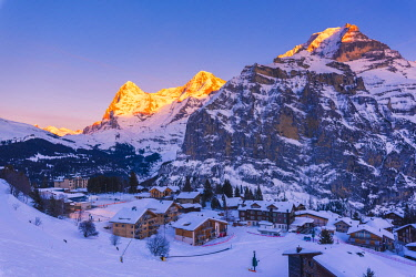 SWI8274AW Mürren, Berner Oberland, canton of Bern, Switzerland. The village with Eiger, Mönch and Jungfrau in the backdrop at sunset