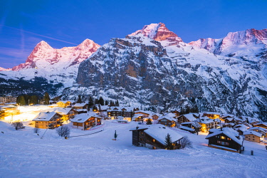 SWI8281AW Mürren, Berner Oberland, canton of Bern, Switzerland. The village with Eiger, Mönch and Jungfrau in the backdrop at dusk